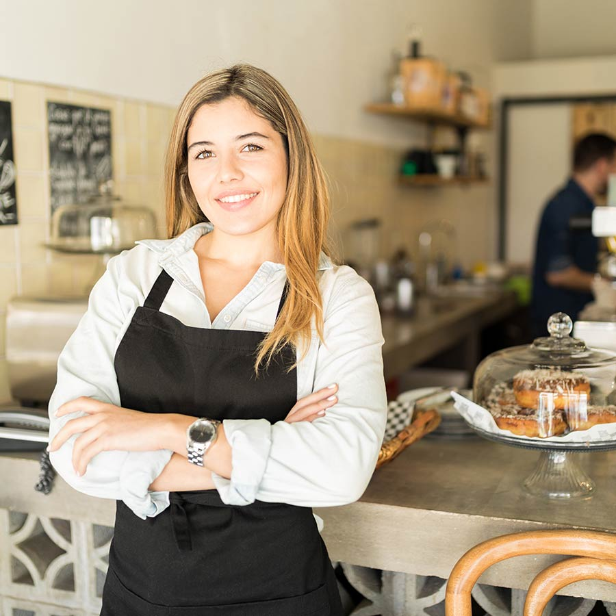 Business Owner Smiling In Store