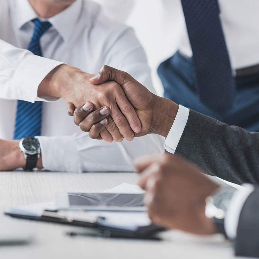 Businessmen Handshake In A Meeting