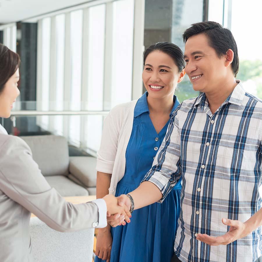 Couple Getting A Loan Handshake