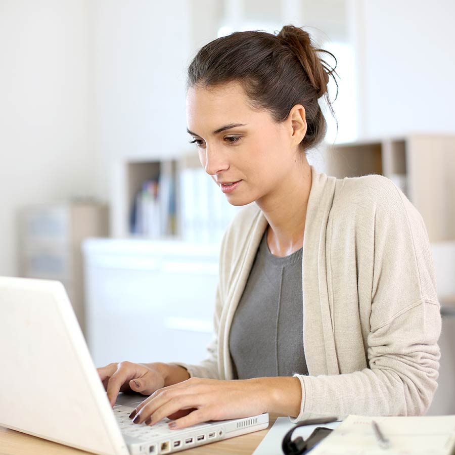 Woman Working In Home Office On Laptop