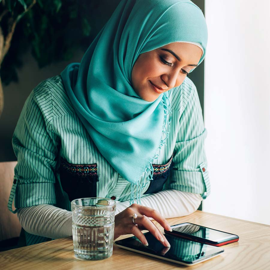Young Somali Woman In Hijab Using Digital Tablet In Office