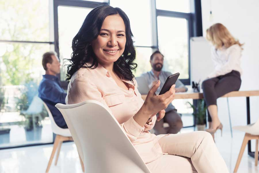 Asian Business Woman Using Smartphone