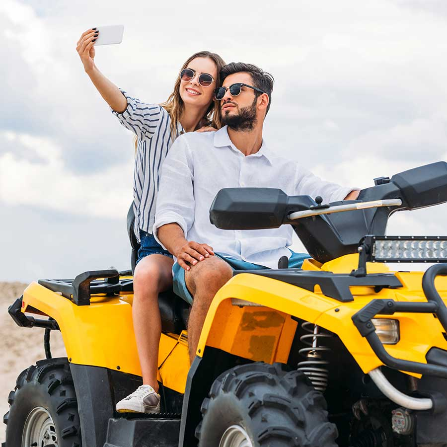Young Couple On Atv