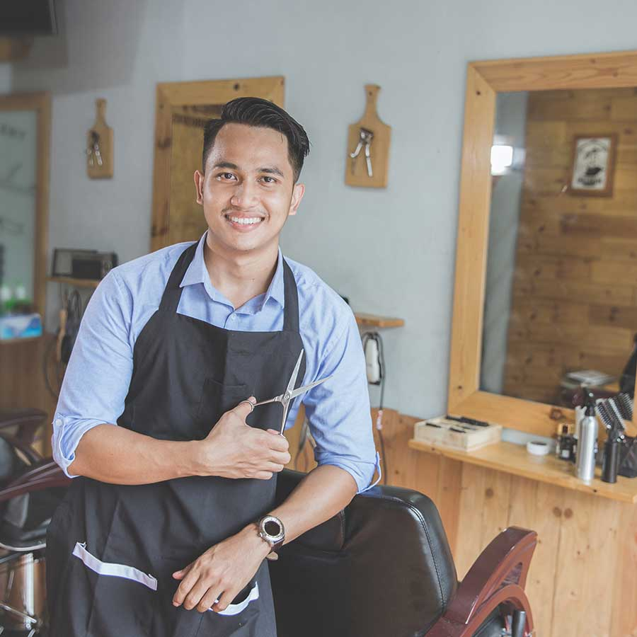 Young Mail Barbership Owner Smiling